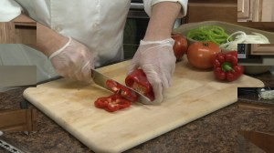 Chef Ted slicing red peppers.