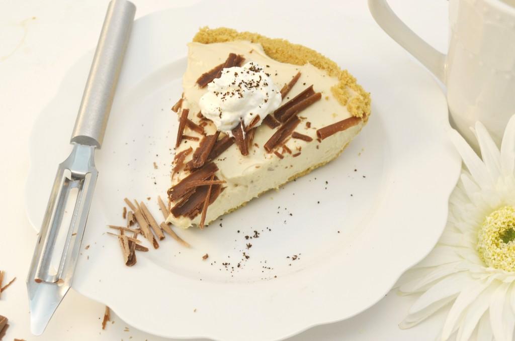 A heavenly vanilla latte cheesecake with a Rada Vegetable Peeler.