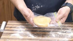 Placing pasta mixture in plastic bag.