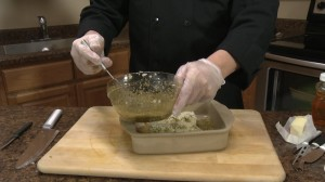 Chef Ted adds sauce to cod.