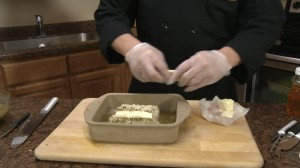 Chef Ted adds butter to citrus cod.