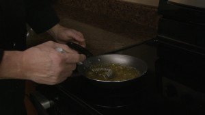 Chef Ted prepares sauce.