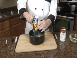 Chef Ted pours Rada Quick Mix Marinara Sauce in a pan.