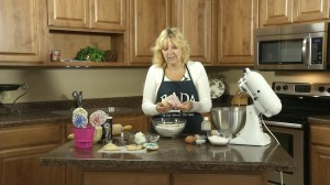 Kristy adds shortening and butter to mixture.