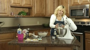 Kristy adds 1 cup sugar to mixture.