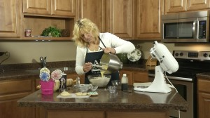 Kristy pours egg mixture into flour.