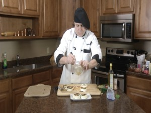 Chef Ted adds olive oil to wheels.
