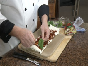 Chef Ted adds fresh basil to mozzarella and sun-dried tomatoes.
