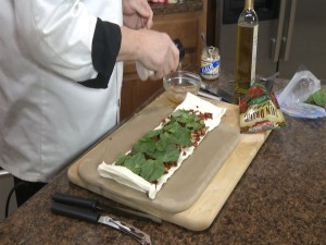 Chef Ted adds seasoning to olive oil.