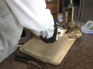 Chef Ted carefully rolls mozzarella cheese.