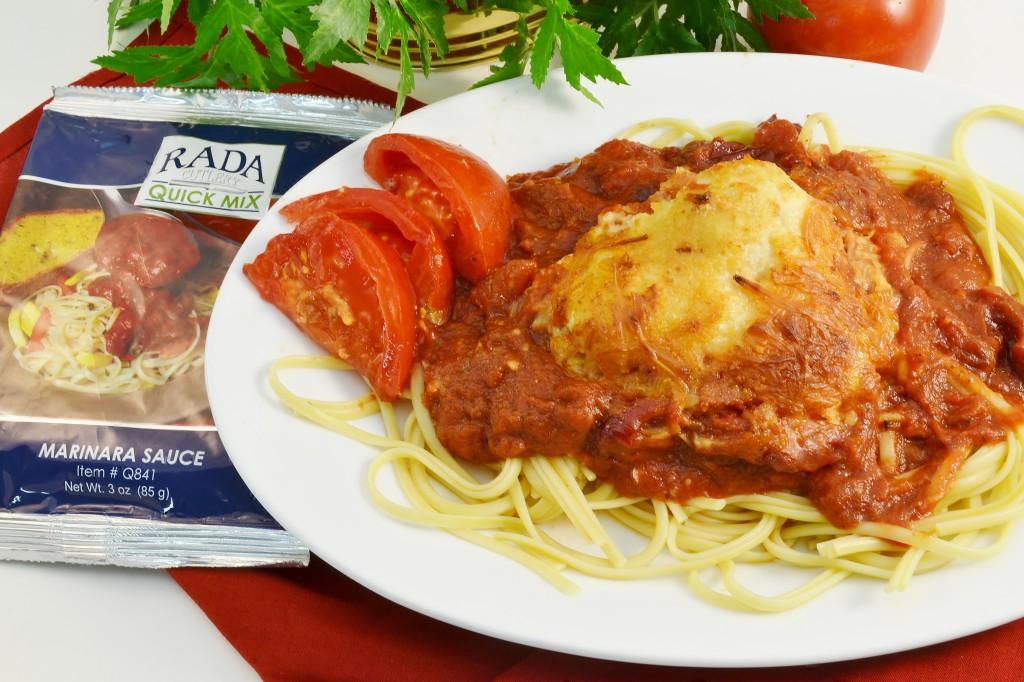 A tasty Chicken Parmesan dish with a Rada Marinara Quick Mix packet.