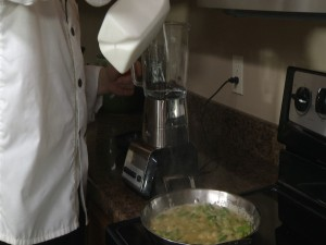 Chef Ted adds milk to blender.