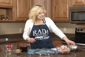 Kristy puts oil in cooking pan.