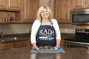 Kristy with completed garlicky chicken wings.