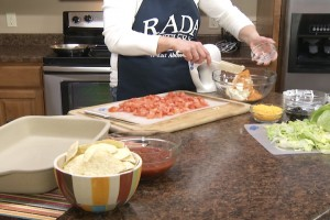 Kristy combines cream cheese and other ingredients.