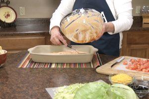 Kristy adds ingredients to Rada Rectangular Baker stoneware.