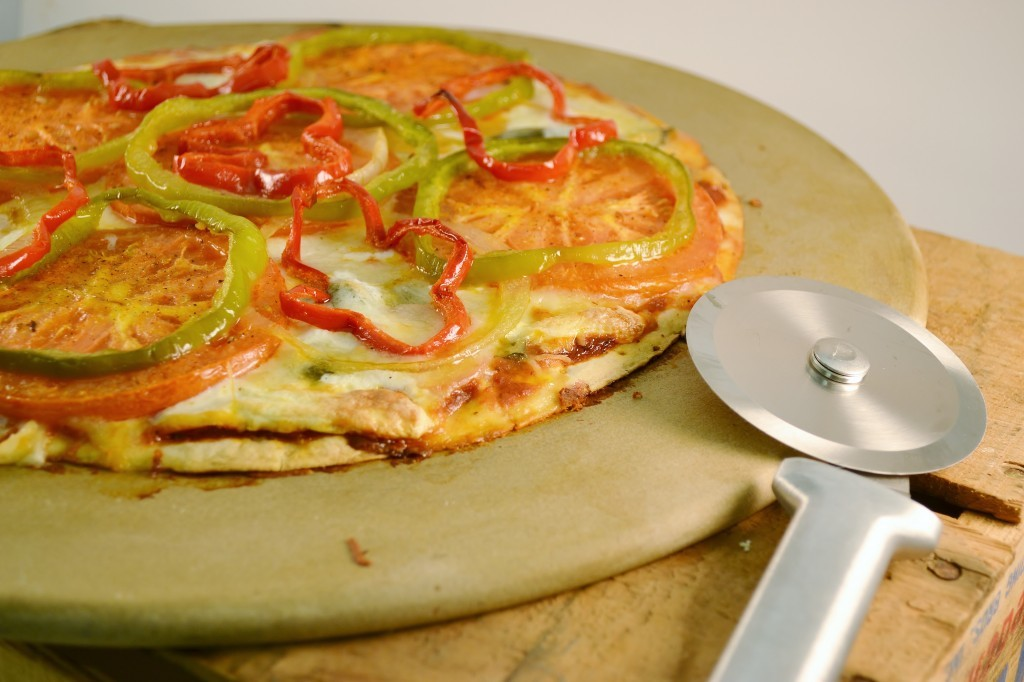 A beautiful thin crust pizza with a Rada Pizza Cutter.