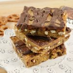 A stack of chocolate pretzel bars made with Rada products and prepared from Rada's 101 Recipes with Chocolate recipe book.