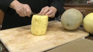 Chef Ted slices a pineapple with the Rada Tomato Slicer.