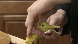 Chef Ted prepares a banana dolphin with chocolate chip eyes.