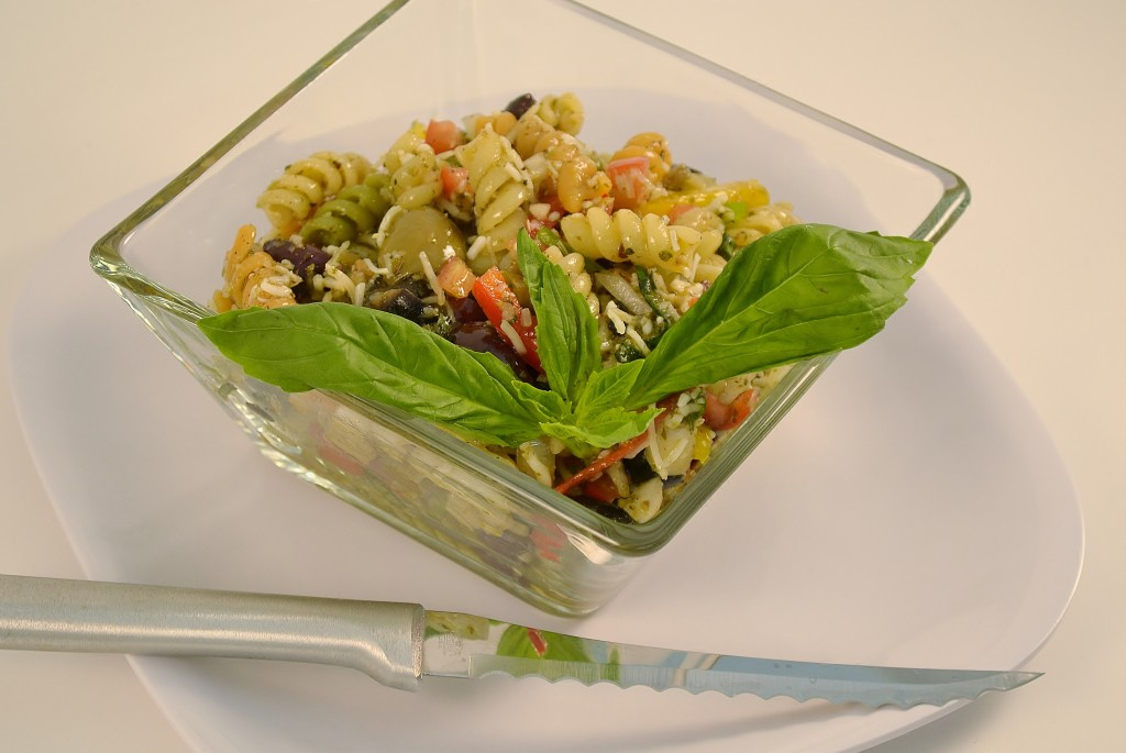 A delicious pesto pasta salad with a Rada Tomato Slicer.