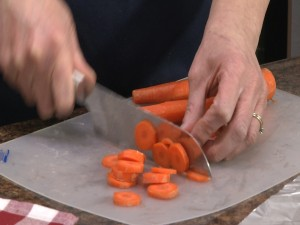 Kristy chops carrots using the Rada Cook's Knife.