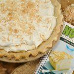 A beautiful coconut cream pie with Rada's No Bake Desserts cookbook.