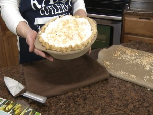 Kristy shows off her completed coconut cream pie.