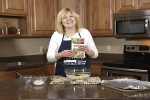 Kristy poses with Unforgettable recipe book.