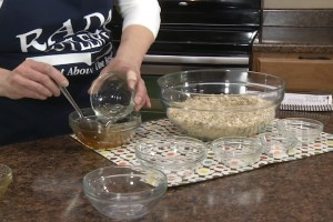 Kristy mixes honey and oil.