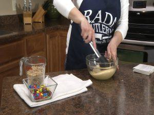 Kristy stirs ingredients together.