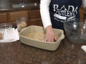 Kristy evenly spreads oatmeal.
