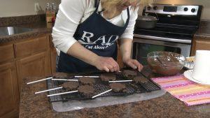 Kristy flips over brownie sticks.