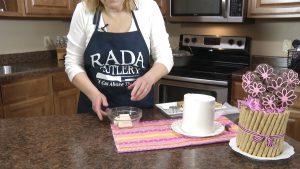 Kristy prepares white almond bark.
