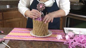 Kristy inserts brownie lollipop in Styrofoam.