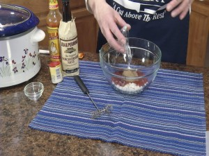 Kristy adds white vinegar.