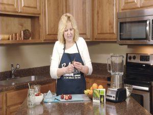 Kristy peels fresh strawberries.