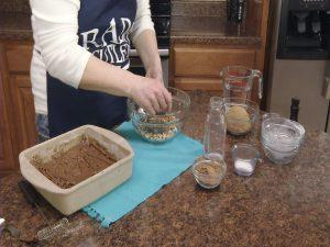 Kristy chops walnuts.