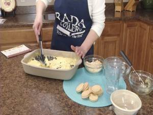 Kristy mixes blueberries.