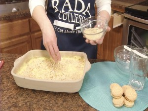Kristy adds lemon cookie crumbles.