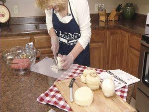 Kristy cuts an onion