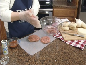 Kristy shapes beef into burger patties.