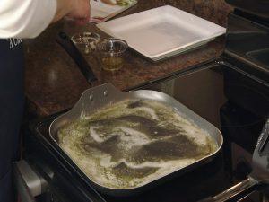 Kristy heats pan.