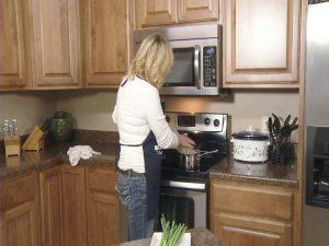 Kristy boils ramen noodles.