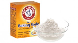 A box of baking soda along with a bowl filled with baking soda.