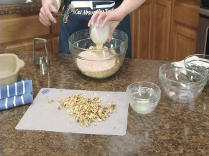 Kristy adds evaporated milk to mixture.