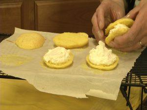 Kristy makes a whoopie dessert sandwich.