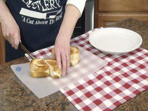 Kristy slices sandwiches.