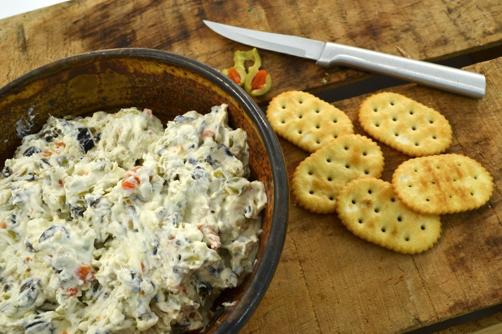 A bowl of olive dip with a Rada Regular Paring knife.