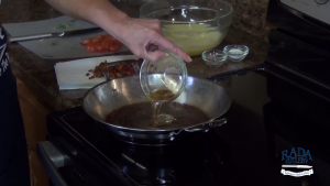 Kristi pours drippings in pan.